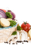 Vegetables in a basket isolated on white Royalty Free Stock Photo