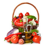 Vegetables in a basket and olive oil Royalty Free Stock Photos
