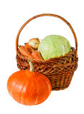 Vegetables in basket and pumpkin isolated on white Royalty Free Stock Image