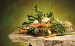 Vegetables. Basket of vegetables on a stone table stock image