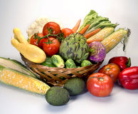 Vegetables in basket. On white background Royalty Free Stock Images