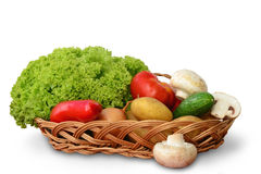 Vegetables in a basket on white Royalty Free Stock Photos