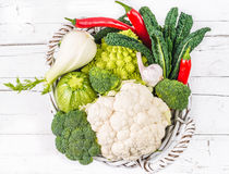 Vegetables in basket on white rustic wood. Stock Image