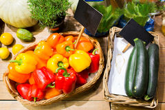Vegetables in baskets with nameplates at market Stock Image