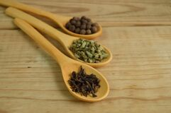 Vegetables and Beans on Brown Wooden Measuring Spoon Stock Photos