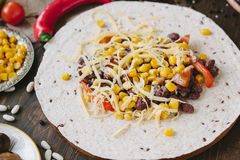 Vegetables, beans and cheese over tortilla bread - vegetarian mexican salad tacos. Vegetables, beans and cheese over tortilla bread - vegetarian mexican salad Stock Photos