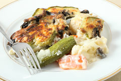 Vegetables in bechamel with fork Royalty Free Stock Photos