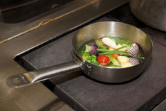 Vegetables are being boiled in pan Royalty Free Stock Images