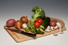 Vegetables being prepared. On a chopping board Stock Image