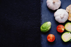 Vegetables on a black stone plate Royalty Free Stock Images