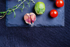 Vegetables on a black stone plate Stock Images