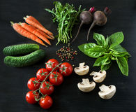 Vegetables on a black wooden background Royalty Free Stock Image