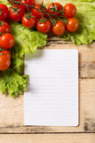 Vegetables and blank paper on wood background Stock Photography