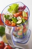 Vegetables in blender. Sliced fresh vegetables in blender close up shoot stock photo