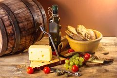 Vegetables on board, cheese and oil Stock Photo