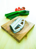 Vegetables, board and chopper Stock Image