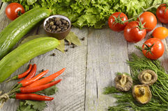 Vegetables border on wood Stock Photos