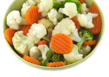 Vegetables in bowl isolated closeup. Assorted vegetables in green bowl isolated on white closeup royalty free stock image