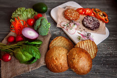 Vegetables and bread rolls for a vegetarian burger Royalty Free Stock Photography