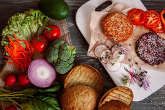 Vegetables and bread rolls for a vegetarian burger Royalty Free Stock Images