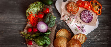 Vegetables and bread rolls for a vegetarian burger Royalty Free Stock Photo