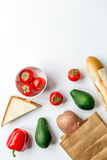 Vegetables and bread on white desk background top view mock-up Royalty Free Stock Photography