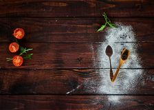 Vegetables on the brown kitchen table royalty free stock photography