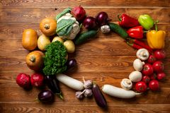 Vegetables on a brown wooden background and a place for the inscription stock photo