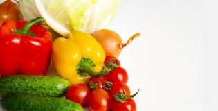 Vegetables Bulgarian pepper tomatoes cabbage cucumbers onions and garlic on a white background stock photo