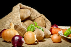 Vegetables in burlap sack Royalty Free Stock Photos