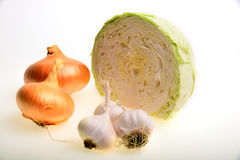 Vegetables. Cabbage, onion and garlic on white Stock Photography
