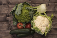 Vegetables. Cabbage, zucchini and tomatoes on a background of wooden boards Royalty Free Stock Photography