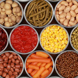 Vegetables in cans. Different kinds of vegetables such as corn, peas and tomatoes in cans Stock Photos