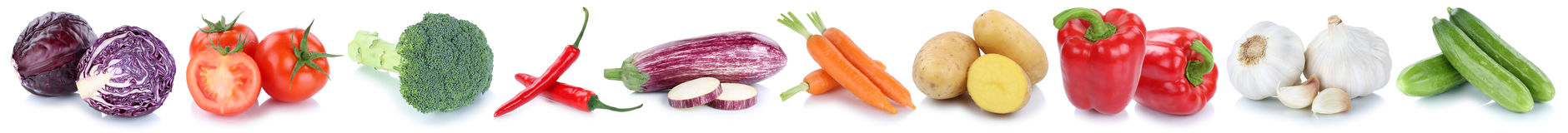 Vegetables carrots tomatoes fresh cucumber potatoes isolated in. Vegetables carrots tomatoes fresh cucumber potatoes isolated on a white background in a row Royalty Free Stock Images