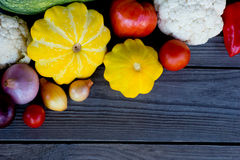 Vegetables: cauliflower, squash, bell peppers, onions and tomatoes. Stock Photo