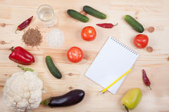 Vegetables and cereals and notebook on a wooden table. Healthy E Stock Image