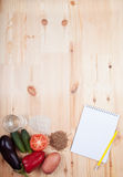 Vegetables and cereals and notebook on a wooden table. Healthy E Stock Photography