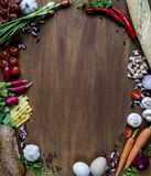 Vegetables, cheese, bread and eggs on wood. Bio Healthy food, herbs and spices. Organic vegetables on wood. Mock up with. Vegetables royalty free stock images