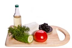 Vegetables, cheese and oil on the cutting board Royalty Free Stock Photography