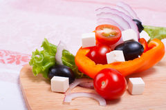 Vegetables, cheese and olives on the kitchen blackboard Royalty Free Stock Photography