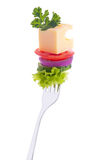 Vegetables, Cheese, Parsley On A Fork. Royalty Free Stock Photos