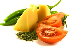 Vegetables and cheese on white. Background Royalty Free Stock Images