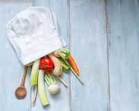 Vegetables in chef's hat cooking food abstract Stock Photo