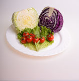 Vegetables. Cherry tomato, cabbage and lettuce Royalty Free Stock Photography