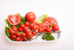Vegetables. Cherry tomato, parsley and lettuce Royalty Free Stock Image