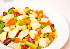 Vegetables and chicken breast Stock Images