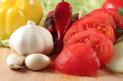 Vegetables: chili, onion, garlic, tomatoes Stock Images
