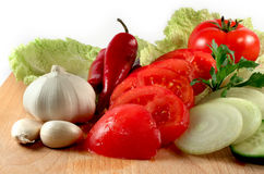 Vegetables: chili, onion, garlic, tomatoes Royalty Free Stock Photos