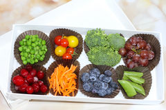 Vegetables instead of chocolate. Tray of vegetables and fruits instead of chocolates Stock Photos