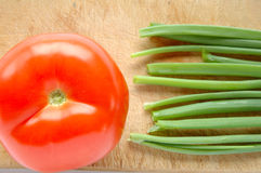 Vegetables on chopping board Royalty Free Stock Image
